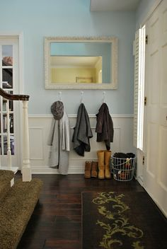 gorgeous and oh so simple entry way (for the bottom of the stairs in the basement - garage door) just hooks, basket, and maybe a tray in case those boots are wet/snowy.