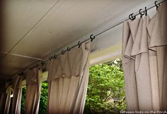 Drop clothes used for porch curtains  =  Rings from Walmart  Just turn down extra length   no sew   conduit pipe for curtain rods.  Pretty.....