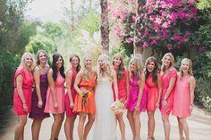 bridesmaids in pink, fuchsia, purple, and orange // photo by Studio Castillero