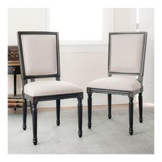 Set of two birch wood side chairs with fluted legs and linen upholstery.Product: Set of 2 side chairs   Construction ...