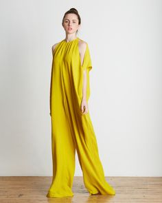 TOME's Oversized Matelasse Jumpsuit in Citron is crafted from distinctly woven matelassé fabric with vertical ribbing. This summer perfect Citron yellow jumpsuit features dolman sleeves with dropped s
