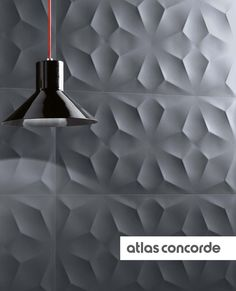 Polyhedral geometrical patterns in relief run on the surface sculpted by light | atlasconcorde.com | Ceramic Wall Tiles | Made in Italy