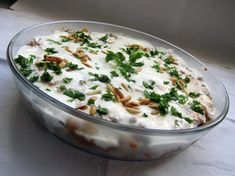 Fatteh - Arabic/Lebanese-Syrian-Palestinian Food - Yoghurt with chick peas, pine nuts and parsil.
