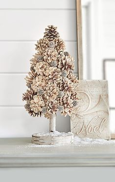 Pinecones of various shapes and sizes come together to make this gorgeous DIY pinecone tree decoration. To make this DIY pinecone project, hot glue large pinecones around a foam cone starting at the top. Fill in any gaps with smaller pinecones. Noel Christmas, Simple Christmas, Christmas Wreaths, Christmas Tree Pinecones, Pinecone Christmas Crafts, Homemade Christmas, Rustic Christmas Ornaments, Large Christmas Tree, Christmas Gifts