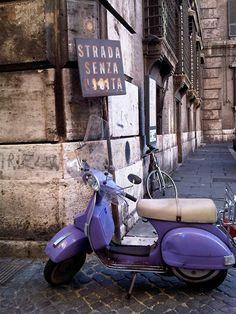 Violet vespa at a dead end street. (From Mozarellamamma.com)