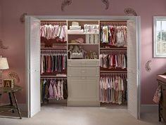 Baby girl's closet...notice the triple hang?  Genius!