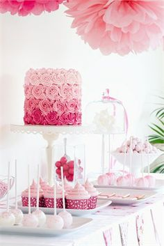 Wedding cake with a pink ombre, displayed on a lolly buffet