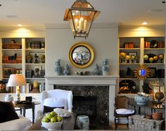 Cote de Texas' lovely symmetrical l.r. with gorgeous details--blue and white porcelains, mirrors, furnishings, lantern