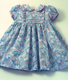 "Items similar to Liberty ""Poppy's Meadow"" Frilly Dress on Etsy Baby Girl Dress Patterns, Little Girl Dresses, Girls Dresses, Flower Girl Dresses, Cotton Frocks For Kids, Frocks For Girls, Toddler Dress, Baby Dress, Kids Dress Wear"