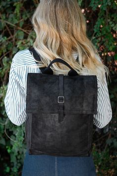 This black canvas and leather TOMS Trekker backpack has all the compartments you need to get from A to B. With an interior padded 13 inch laptop pocket, exterior and interior slip pockets and a side zip pocket you'll have room for it all.