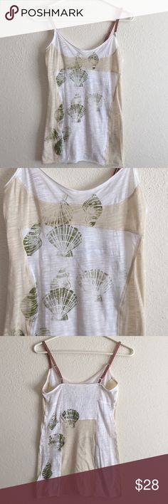 Free People Seashell Tank Top Brand new...never worn! Lightweight tank with seashells adorned on the font and back! Elastic back for an easier fit!! Adjustable striped straps! Very cute on! Free People Tops Tank Tops