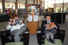 Lounging with magazines in the library.