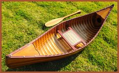This museum quality, Cedar Strip Canoe display model is brand new, fully assembled and ready for display (not a kit). This beautiful Canoe display model is handcrafted from strips of 100% Canadian western red cedar wood. The hull is then covered with an invisible layer of clear fiber glass cloth which is bonded with watertight clear epoxy resin and is then coated with marine varnish. This combination of fiberglass & epoxy is completely transparent so that the beauty of the wood shows thr...