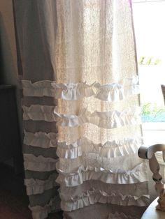 canvas + white ruffle curtains - maybe with a few less ruffles