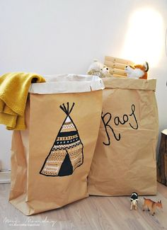 Decorate paper bags to make personal and fun storage in the kids room.