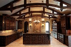 Gorgeous Architecture in this Kitchen..love the Arched trusses, beautiful cabinetry, Stone/Tile work on the backsplash & back wall, love the Island, Lighting, etc...