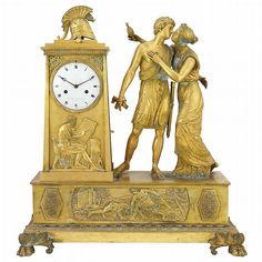 Empire Gilt-Bronze Mantel Clock  Early 19th century  The enameled clock 4 3/4 inch dial signed Le Roy br. de Madame/A Paris, in the form of a pylon surmounted by a helmet, the front depicting an architect at work, the side with a winged flaming torch opposed by a paneled door with addorsed winged dolphins, the platform with the figures of Odysseus with a broken sword embraced and kissed by Penelope.