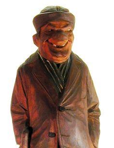 Photo of a carving of Mac McCane Hobo.