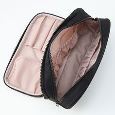 Nylon double zip cosmetics case. A stylish multi-compartment zip-up case ideal for toiletries or make-up whilst travelling.