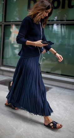 street style. cropped sweater worn with pleated maxi skirt & slides