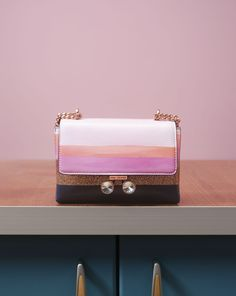 ADD A Touch of sparkle to your evening ensemble with the elegant ORCHID clutch bag.