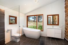 Steel sheeting used to craft the walls of the bathroom 10 Fabulous Bathrooms with Industrial Style