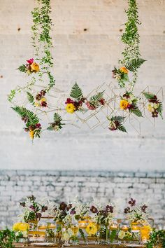 quite cool geo introduction. Geometric hanging decor with flowers.