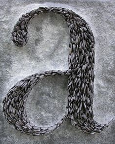 "Tom Stogdon, ""Alphabet Series 1."" Hammered lead, inlaid quarried slate"