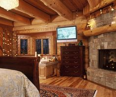 Highlands Log Structures ~ Master Bedroom - is that a jacuzzi tub I see in this bedroom? Perfect room!