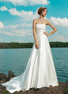Sincerity wedding dress style 3659 Strapless soft sweetheart ruched shimmer charmeuse with beading on the bodice and drop waist, circular cut skirt with buttons on back zipper into a chapel train.