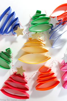 Learn how to make the cutest paper Christmas tree garland in this post. It's so easy to create a cute Christmas garland! garland decorating ideas How to Make the Cutest Paper Christmas Tree Garland - Average But Inspired Noel Christmas, Christmas Crafts For Kids, Christmas Projects, Holiday Crafts, Holiday Fun, Paper Christmas Trees, Homemade Christmas Tree Decorations, Diy Christmas Tree Garland, Creative Christmas Trees