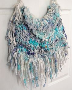 Boho Fringe Bag, knit with the thin blue yarn from that failed scarf on small needles