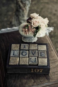 Love spelled out... could be done with stone from the beach if I find a way to cut stones OR ill use tiles from Hoem Depot