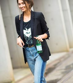 Black blazer, graphic t-shirt, and jeans