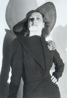 joan crawford in very striking dress hat is probably from 1930s possibly