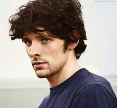Colin Morgan from merlin scruffy suits him