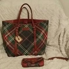 Dooney Burke tote with wristlet Multi color Dooney n Burke tote with matching wristlet, excellent condition, used a few times, very spacious. Rare tote. Dooney & Bourke Bags Totes