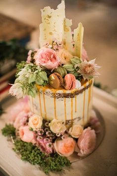 Semi naked wedding cake with white chocolate shards, caramel drip, macarons and textured flowers   Jazelle Venter Photography