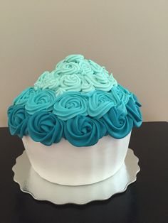 Smash cake, giant cupcake. Teal Ombre icing. Vanilla cake with a marshmallow fondant cupcake shell      Find me on Facebook Custom Creations