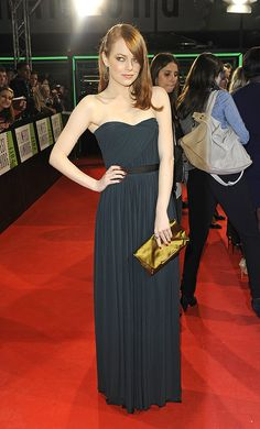 Emma knows how to pull off a deep navy gown, like she did in this Lanvin frock at a red carpet event in Germany. Copy her look by belting your long dresses at the natural waist.