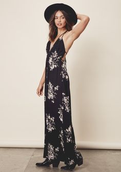 Talia Dress - Sleeveless, floral printed maxi dress featuring pockets, a braided accent empire waist and straps with a sexy, strappy tie back detail and halter. #LOVESTITCH #maxi #bohodress