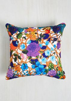 You'll be bowled over by how refreshed you feel after a nap with this bright pillow! An eye-catching design by Juliana Curi for DENY, this bold cushion showcases purple, blue, and pink flowers atop gold chains - mixed patterns that make for marvelous dreams.