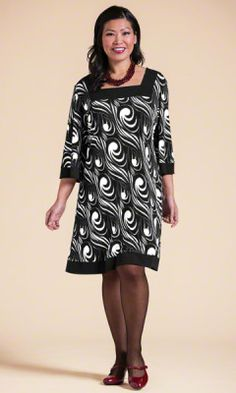 KAYCEE DRESS Solid black accents at square neckline, hem and sleeve hems, 3/4 bell sleeves, 97% polyester/3% spandex, Machine wash. Comes in plus sizes