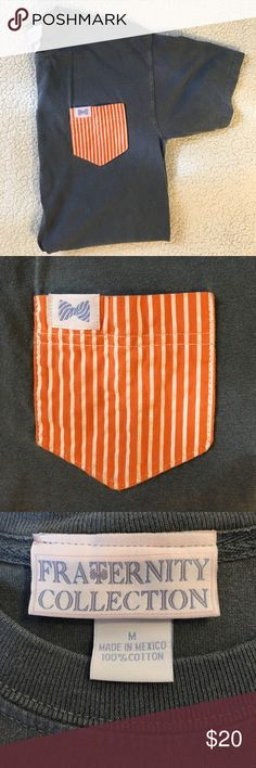 Fraternity Collection short sleeve shirt This customized short sleeve shirt was only worn once and is in great condition! It's a navy (hint of gray) shirt with an orange and white striped pocket. Fraternity Collection Shirts Tees - Short Sleeve
