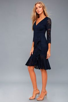Lulus Exclusive! We have all the time in the world for the Make Time For Me Navy Blue Lace Midi Dress! Sheer lace forms elegant three-quarter length sleeves that frame a V-neck, princess-seamed bodice. Unique ruffle detail cascades down the figure flaunting, bodycon midi skirt that ends in a ruffled hem. Hidden back zipper. #mididress