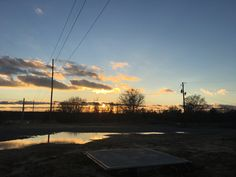 Photo 1/2  Sunsets are my favorite. This photo was taken in an abandoned lot behind my apartment, and it made the reflections in the mud puddle catch my eye...