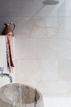 St Adrien Polished Marble tiles & Picasso Cosmo Basin. www.mandarinstone.com