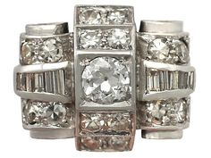 'Large 1.61 ct Diamond Cluster Ring in the Art Deco style - Antique French' http://www.acsilver.co.uk/shop/pc/1-61-ct-Diamond-18-ct-White-Gold-Dress-Ring-Art-Deco-Antique-French-Circa-1930-35p9033.htm