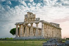 Nicola Mastrandrea: #Paestum was a major #ancient #Greek #city on the #coast of the #TyrrhenianSea in #MagnaGraecia (southern #Italy). The #ruins of Paestum are famous for their three ancient Greek #temples in the Doric order dating from about 600 to 450 BC which are in a very good state of preservation. The city walls and #amphitheatre are largely intact and the bottom of the walls of many other structures remain as well as paved roads. The site is open to the public and there is a modern…