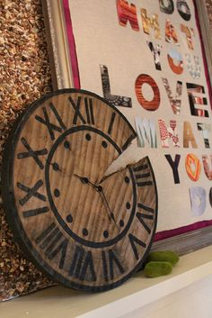 Love this DIY Rustic Pottery Barn-inspired wood slice clock by Kara Paslay Designs!